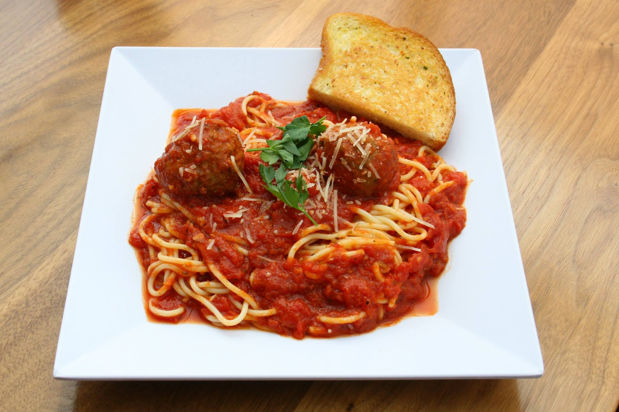 Spaghetti noodles in a rich tomato meat sauce with garlic and Italian ...